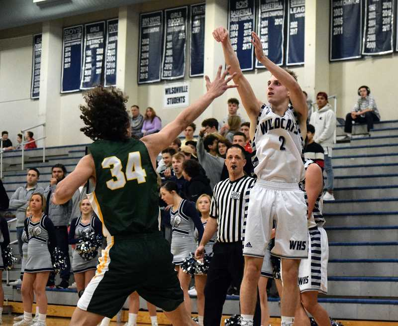 ARCHIVE PHOTO - Senior Caleb Larsen has been a force to be reckoned with defensively and offensively, leading the boys team to a 14-0 record in leage play.