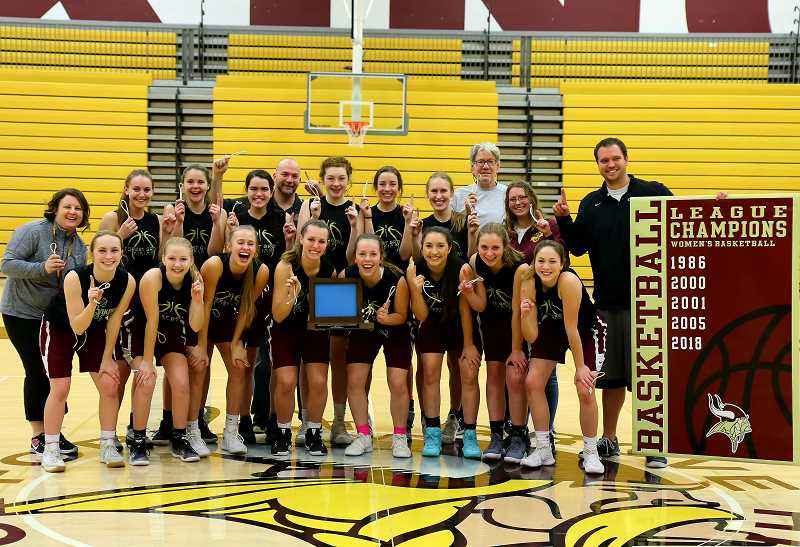 COURTESY PHOTO: VICKI VAN LOO PHOTOGRAPHY - The Forest Grove girls basketball team poses for a photo after claiming their first league title since 2005. Back row (left to right): Assistant Coach Jessica Cox, Audrey Fasching, Kendal Thrush, Delaney Aleshire, Assistant Coach Andrew Garret, Olivia Grosse, Emily Huson, Katie Rebsom, Assistant Coach Duane Anderson, Manager Meagan Mollahan, Coach Dan Lumpkin. Front Row (left to right): Jazzy Murphy, Jen Cool, Amanda Rebsom, Emily Lester, Katie Ellington, Kayleen Domiguez, Ellie Kintz, and Kinsey Barnett