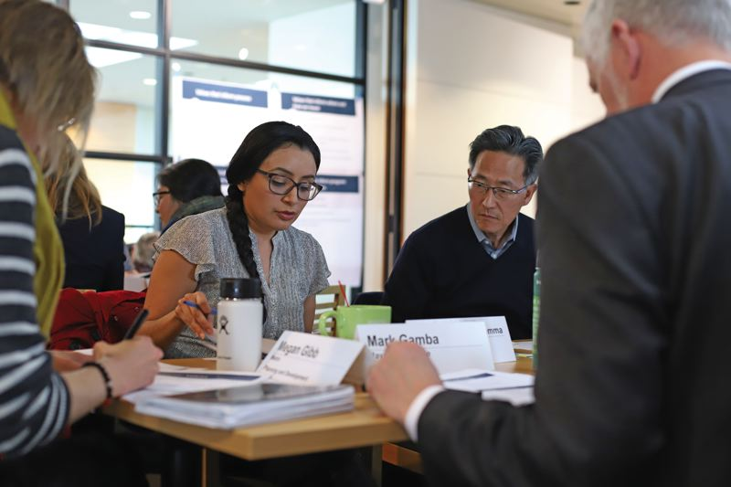 COURTESY METRO - David Douglas School Board member Ana Del Rocio and Central Bethany Development Company president Roy Kim study proposed values for spending affordable houisng funds at a Metro advisory committee meeting last Wednesday.