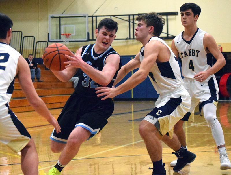 PAMPLIN MEDIA GROUP PHOTO: TANNER RUSS - Lakeridge sophomore guard Ethan McEachern drives to the basket during his team's 56-47 win at Canby on Friday night.