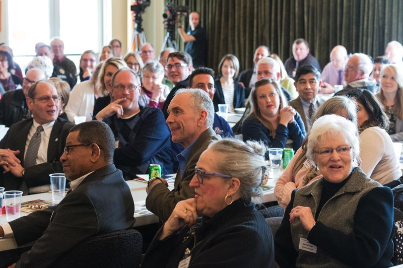 STAFF PHOTO: CHRISTOPHER OERTELL - Guests take in the State of the City addresses given Monday at the Forest Grove Community Auditorium, where both Forest Grove Mayor Pete Truax and Cornelius Mayor Jef Dalin addressed their respective cities' situations.
