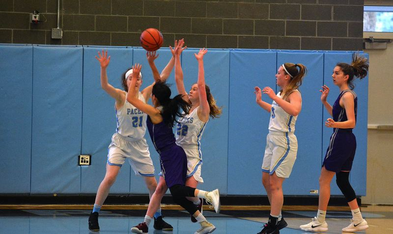 TIMES PHOTO: MATT SINGLEDECKER - Lakeridge forwards Kathryn LeMoine and Sierra Zevenbergen trap Sunset guard Vanessa Lopez in Class 6A play-in action.