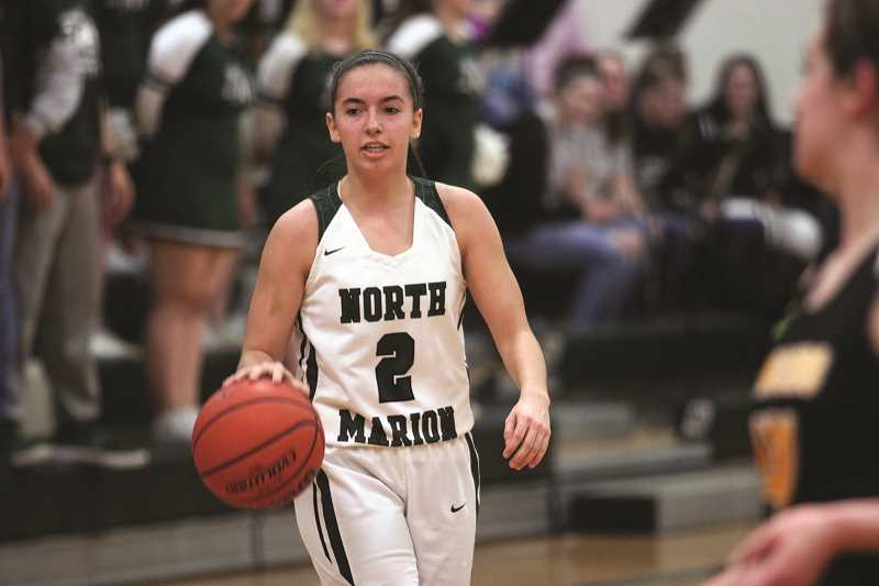 PHIL HAWKINS - Senior Ally Umbenhower led the Huskies with 17 points against Cascade and 24 against South Umpqua on Saturday.