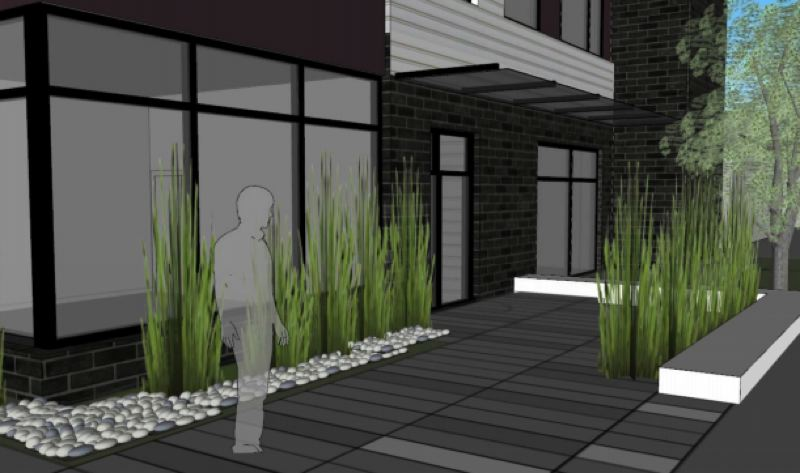 COURTESY RENDERING - The pedestrian pathway for this building between Pine and Oak streets also features landscaping and outdoor lighting.