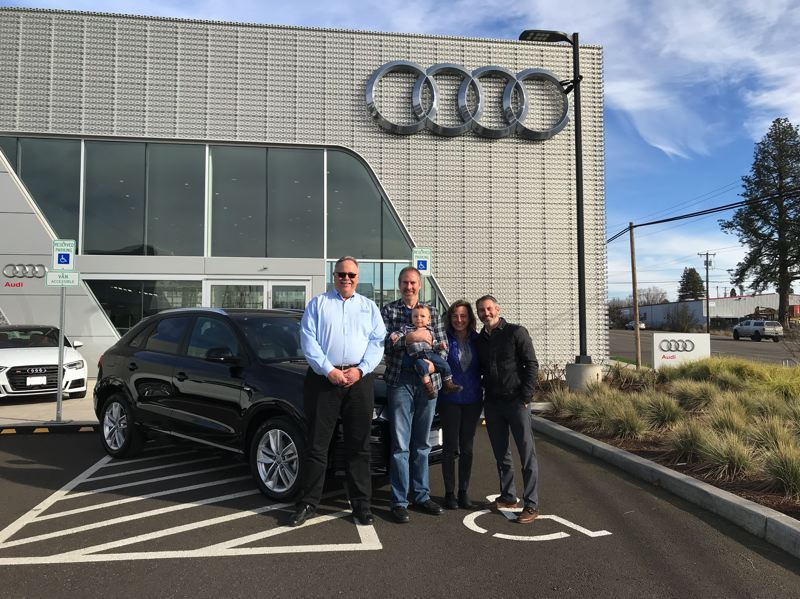 COURTESY PORTLAND INTERNATIONAL AUTO SHOW - The raffle winners at Audi Beaverton. From left: Portland International Auto Show Executive Vice President Greg Remensperger, Joe and Kari Luchsinger  (with Luke), and General Sales Manager Lucas Soltman.