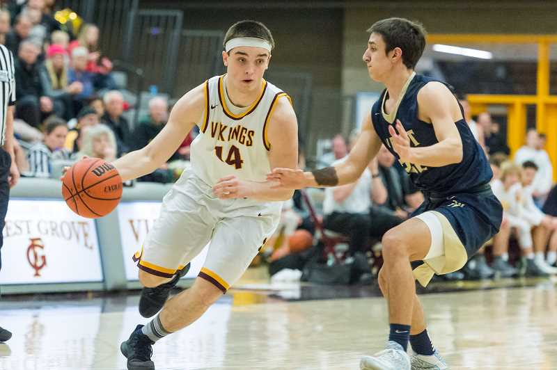 STAFF PHOTO: CHRISTOPHER OERTELL - Forest Grove's Ayden Purcell dribbles around a West Albany defender during the Vikings' game with the Bulldogs earlier this season.