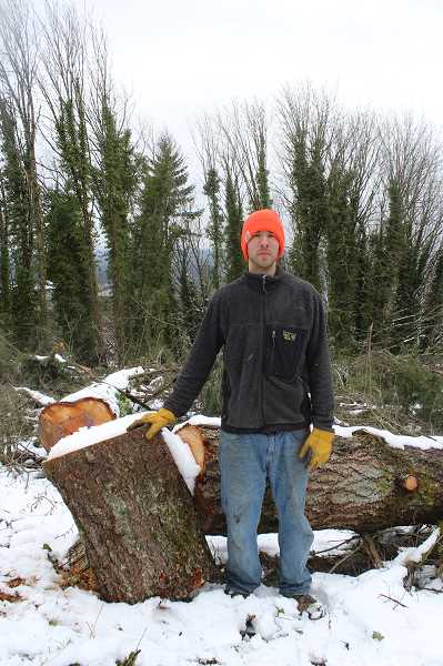 REVIEW PHOTO: ANTHONY MACUK - Luis Pacheco says he's still sorting through the pile of trunks and branches left at the site to assess how many trees were removed.