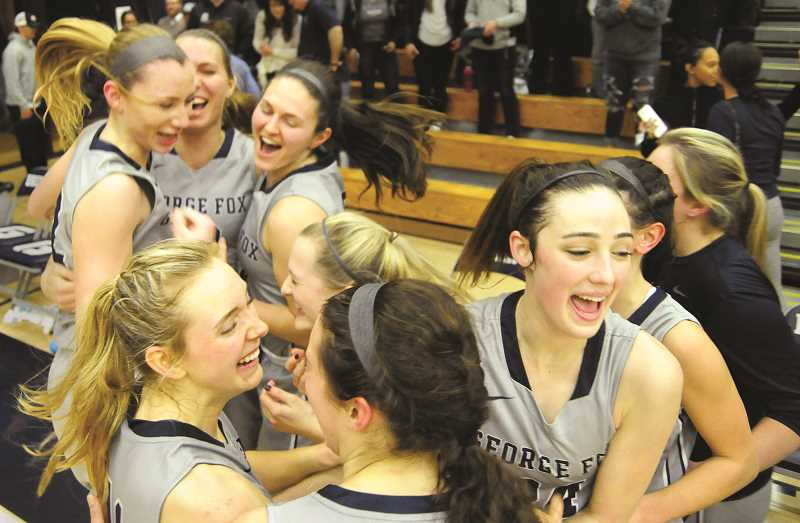 GARY ALLEN - The George Fox women's basketball team celebrates it's 60-50 win over Willamette in the Northwest Conference Tournament championship game Saturday at Miller Gymnasium. The Bruins have won