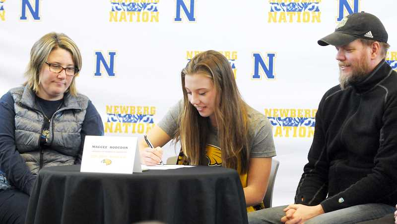 SETH GORDON - Newberg High School senior Maggee Hodgdon signs her national letter of intent to play soccer for NCAA Division II Minnesota-Crookston in a ceremony Feb. 8.