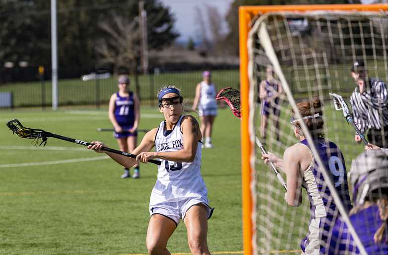 GFU PHOTO - Senior Jess Hanson winds up for a shot during the George Fox women's lacrosse team's 13-10 home victory over Westminster-Salt Lake City Saturday at the Austin Sports Complex. Hanson had five goals and two assists in the win.