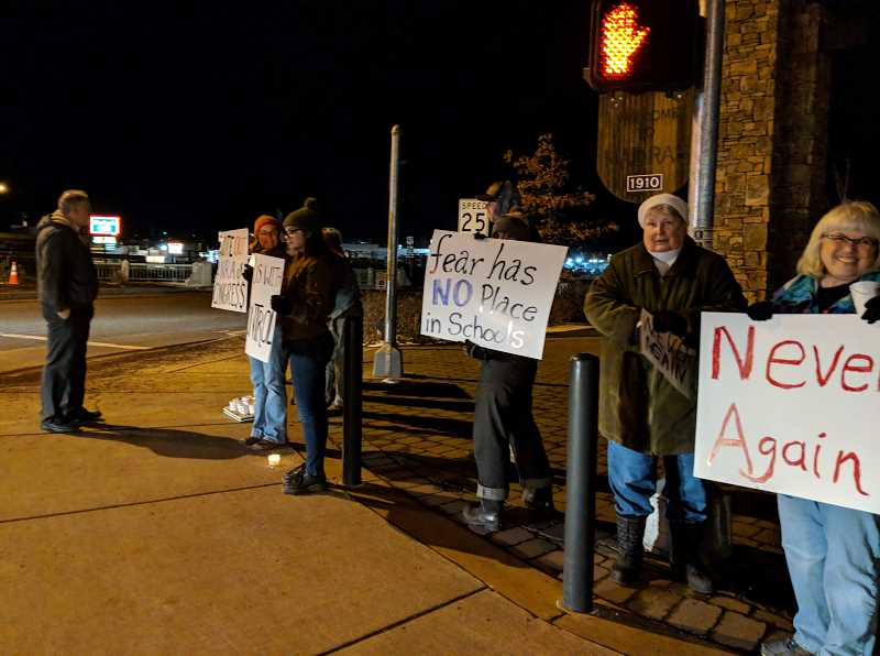 SUBMITTED PHOTO - Local residents held a candlelight vigil at the north Welcome to Madras sign on Saturday, Feb. 4, in honor of the Florida school shooting victims. Group members met at Sahalee Park and walked to the North Y.