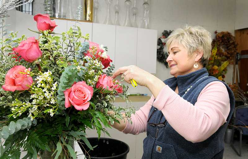 GARY ALLEN - Kelly Buxton continues working with flowers in her new shop, Natures Reflection, to blend both colors and textures of flowers into bouquets.