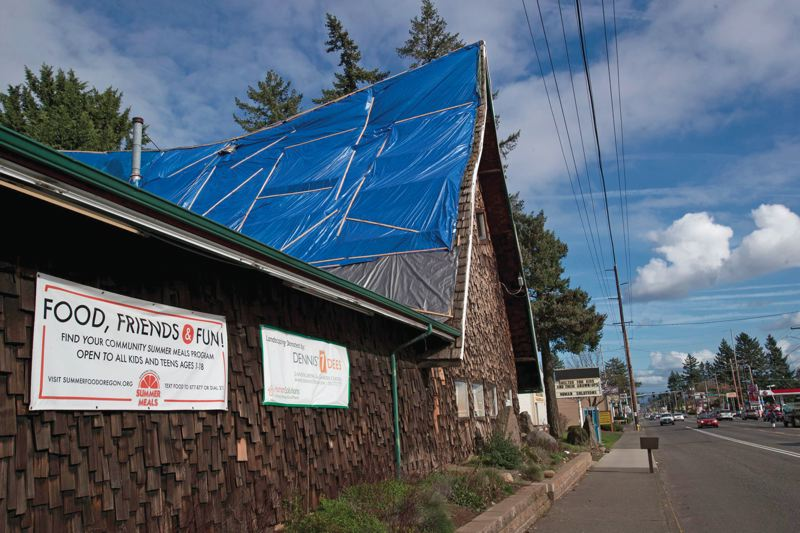 PORTLAND TRIBUNE: JAIME VALDEZ - Large blue tarps were applied to cover a leaky roof at the emergency family shelter run by Human Soultions at Southeast 160th Avenue and Stark Street.