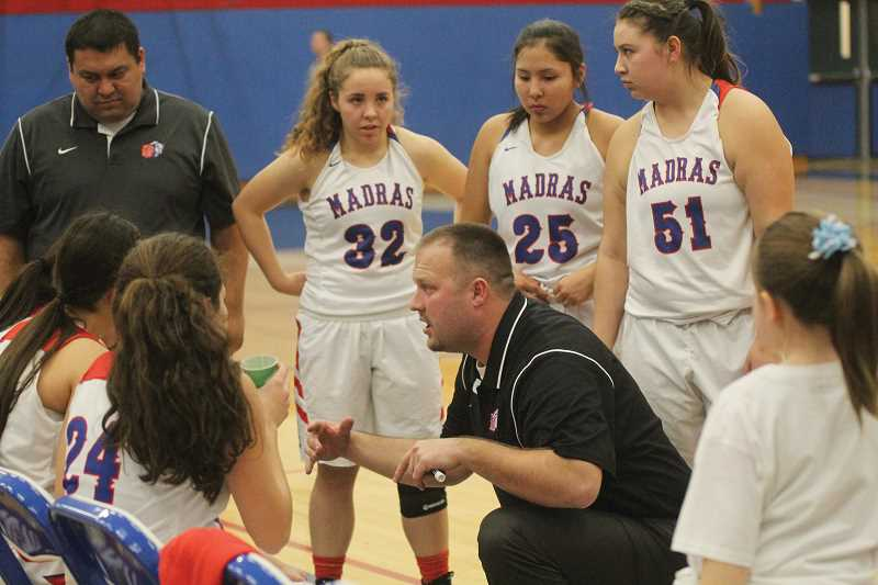 WILL DENNER/MADRAS PIONEER - Madras head coach Zach Lillebo (center) brought a different mindset into the 2017-18 season, hoping to make the experience more fun and less of a grind for the girls.