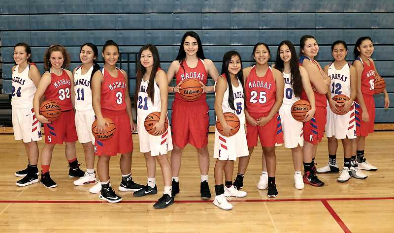 PHOTO COURTESY OF CHARITY DUBISAR/SNAP SHOTS - From left to right, the 2017-18 Madras girls basketball team consists of Jayden Davis, Alesha Freeman, Chloe Smith, Kaliyah Iverson, Monika Stacona, Annie Whipple, Vanessa Culps, Jiana Smith-Francis, Jalaney Suppah, Ellise David, Jackie Zamora and Lynden Harry.