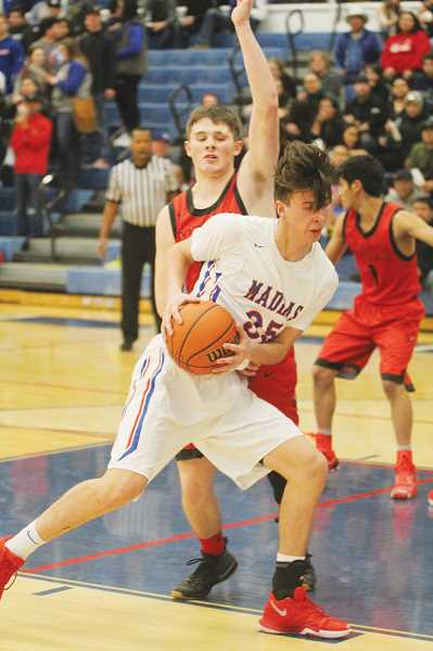 WILL DENNER/MADRAS PIONEER - Tyler Lockey (35) led Madras with 14 rebounds (five offensive), on a night when second-chance points helped the Buffs get over the hump.