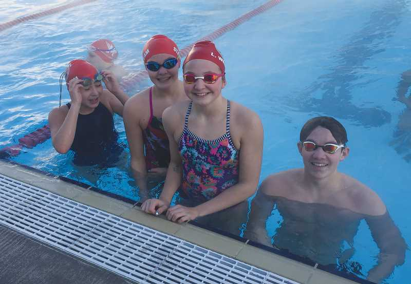 PHOTO COURTESY OF TIM NELSON - From left to right, Madras Swim Team members Kami Ackley, Elli Williams, Lexi Williams and Julian Hollingshead competed in the 11-14 OSI Short Course Championships Feb. 22-25 in Corvallis.