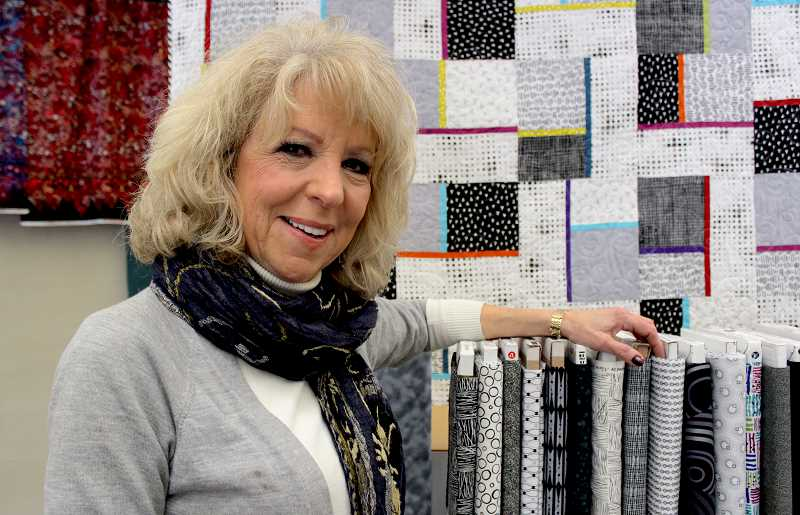 REVIEW PHOTO: SAM STITES - Geri Grasvik has owned and operated The Pine Needle Quilt Shop in downtown Lake Oswego for 25 years. She plans to close the store and retire at the end of March