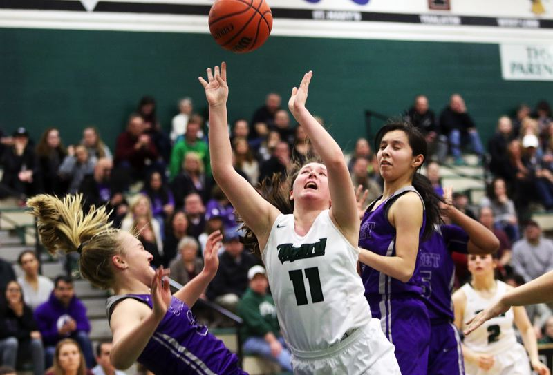 DAN BROOD - Tigard junior Paige LaFountian (11) loses the ball as she goes to the basket between Sunset's Grace Kimball (left) and Vanessa Lopez.