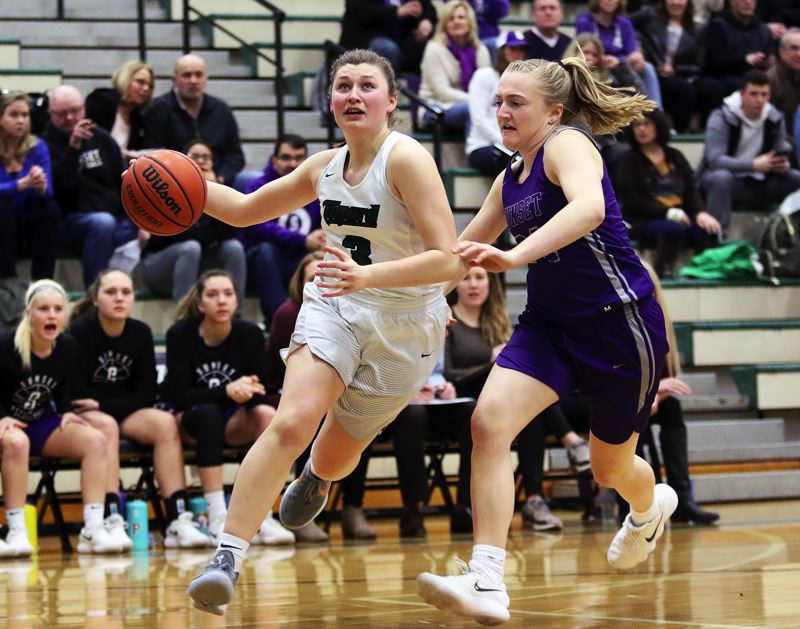 DAN BROOD - Tigard junior guard Campbell Gray (left) looks to drive past Sunset's Grace Kimball during Tuesday's state playoff game.