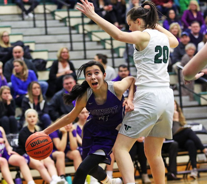 DAN BROOD - Sunset junior Vanessa Lopez (left) looks to drive past Tigard's Caitlin Erickson during Tuesday's playoff game.