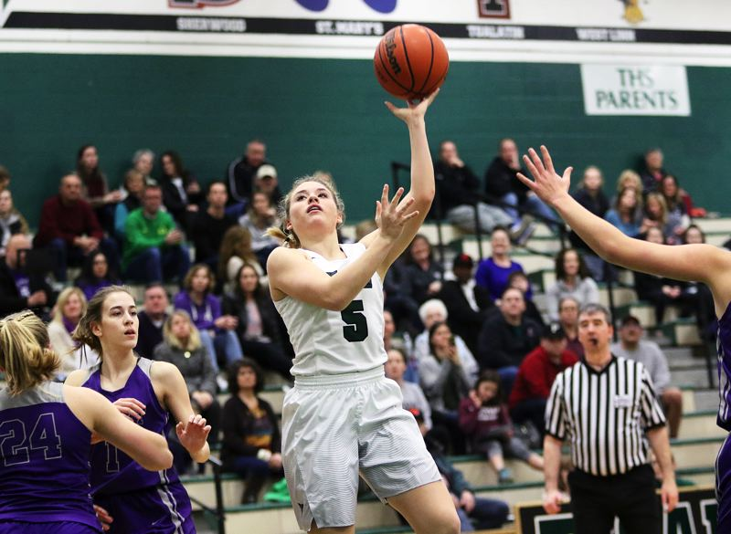 DAN BROOD - Tigard senior guard Gabby McGaughey puts up a shot during the Tigers' win over Sunset.