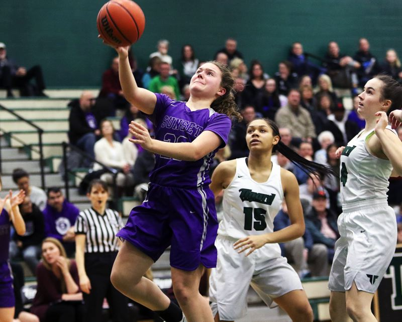 DAN BROOD - Sunset sophomore Mikaela Byrnes goes to the basket during Tuesday's playoff game at Tigard.