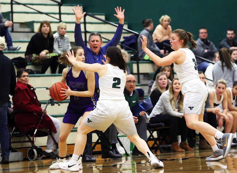 DAN BROOD - Tigard sophomore Kennedy Brown (2) and junior Campbell Gray, in front of Tigard coach Steve Naylor, converge on Sunset senior Delaney Ragan.