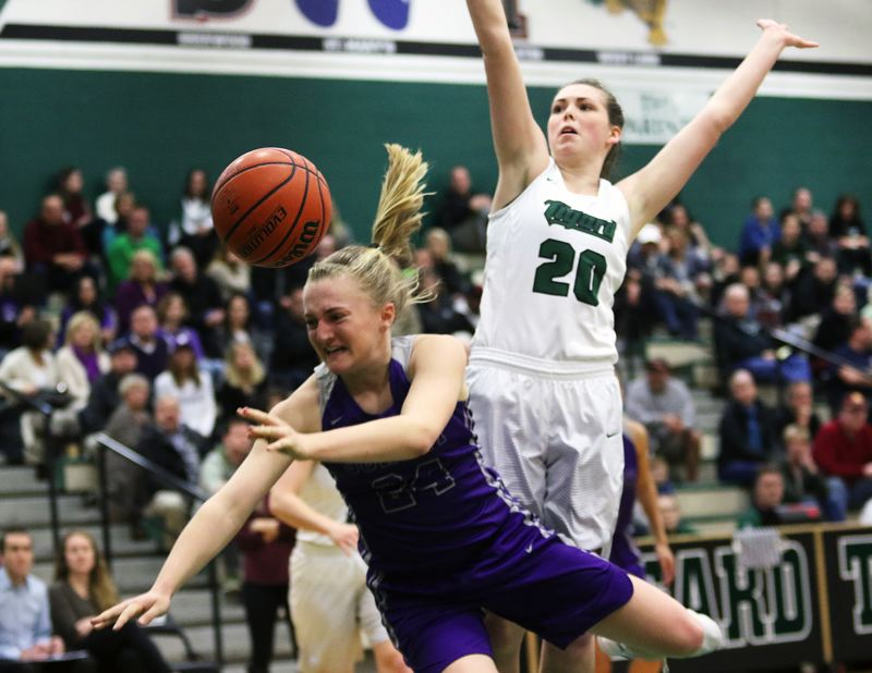 DAN BROOD - Sunset sophomore Grace Kimball is fouled on the drive during Tuesday's playoff game at Tigard.