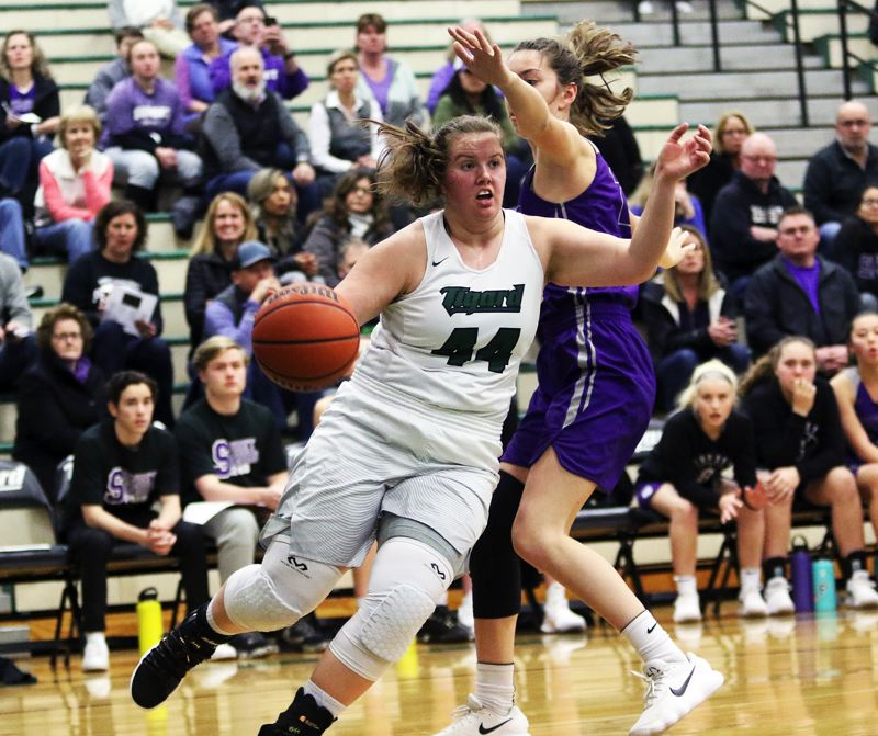 DAN BROOD - Tigard junior post Dani Lyons looks to get past a Sunset defender during Tuesday's game.
