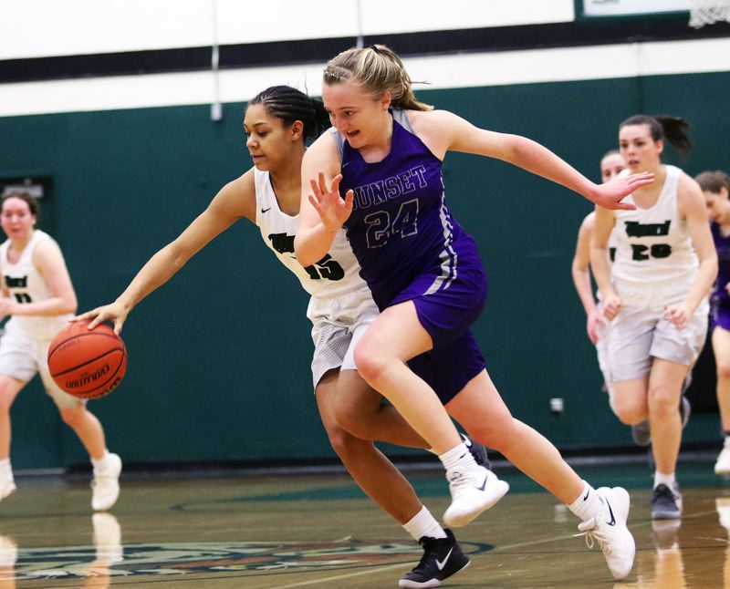 DAN BROOD - Tigard freshman Ajae Kadel (left) gets to a loose ball before Sunset sophomore Grace Kimball can during Tuesday's game.