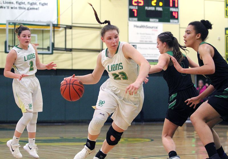 TIDINGS PHOTO: MILES VANCE - West Linn freshman Makayla Long drives to the basket during her team's 57-36 win over West Salem in the first round of the Class 6A state playoffs on Tuesday at West Linn High School.