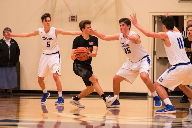 TIMES PHOTO: LON AUSTIN - Valley Catholic senior Ben Robbins and the Valiant boys basketball team beat Crook County in the 4A playoffs.