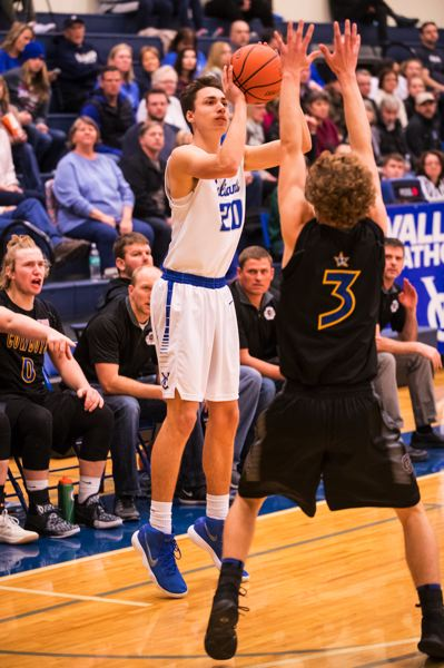 TIMES PHOTO: LON AUSTIN - Valley Catholic senior Andrew Plambeck caught fire in the second half against Crook County.