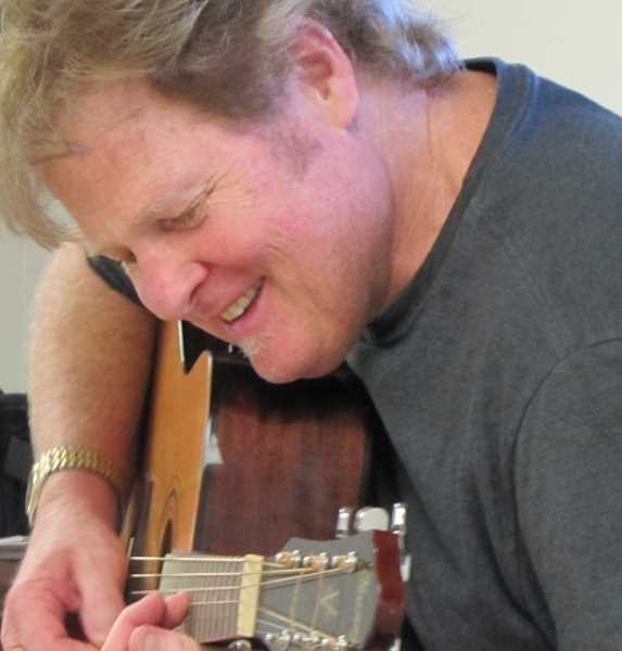 SUBMITTED PHOTOS  - Bill Price will be teaching ukulele and guitar lessons through West Linn Parks and Recreation starting April 2. Sign up now.