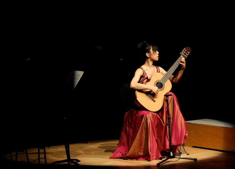 SUBMITTED PHOTO  - Chinese guitarist Xuefei Yang will present the Portland Classic Guitar Concert at Marylhurst University March 9 at 8 p.m. Get tickets online at portlandclassicguitar.com.