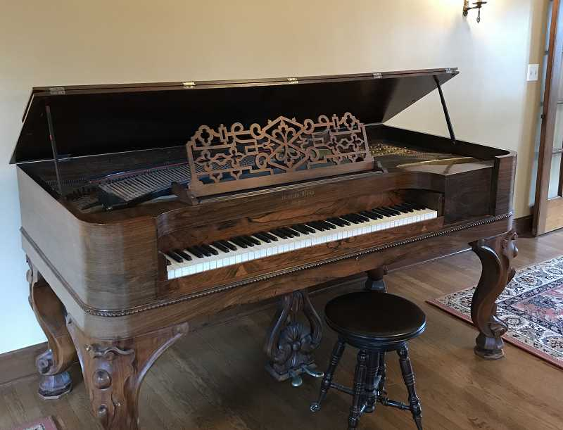 TIDINGS PHOTOS: PATRICK MALEE - The piano was restored about 10 years ago and is in pristine condition after arriving at the McLean House in early February.