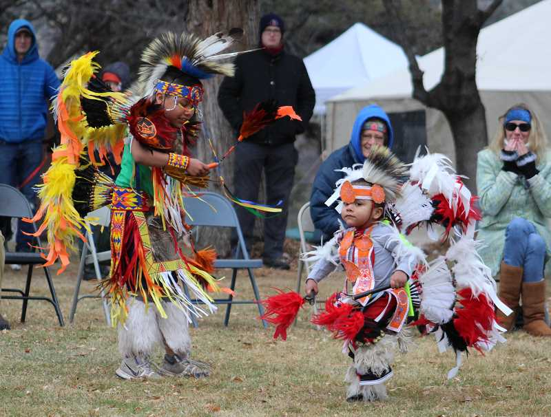 HOLLY M. GILL - Julian Stwyer, left, and his youngest brother, Asher, 3, perform the boys' Fancy Dance on Sunday at Eagle Watch, much to the delight of visitors. The boys' brother, JoeRay, 6, also took part in the dance, at members of the Quartz Creek Drummers and Dancers.