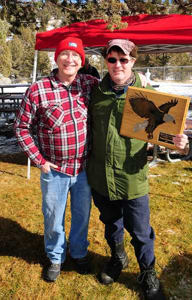 BILL VOLLMER FOR THE MADRAS PIONEER - Paul Patton, of the Oregon Parks and Recreation Department, congratulates Thad Fitzhenry, wildlife biologist for Portland General Electric, the winner of the Order of the Eagle plaque for 2018.