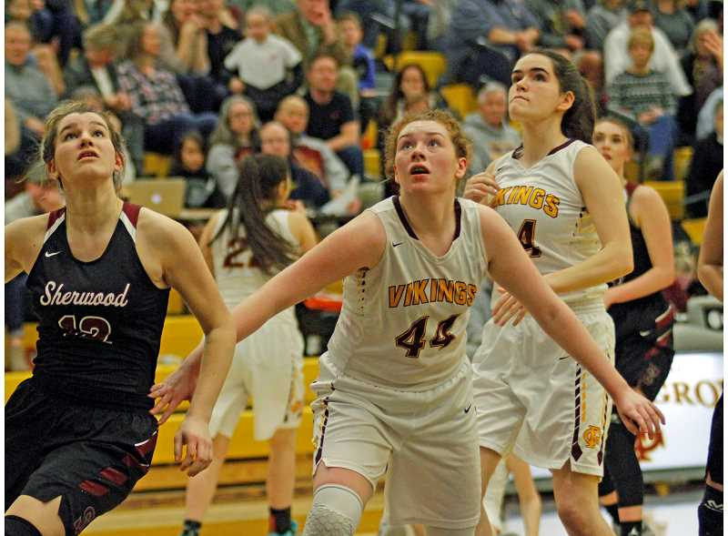 STAFF PHOTO: WADE EVANSON - Forest Grove's Olivia Grosse battles for rebounding position during the Vikings' playoff game versus Sherwood Feb. 27 at FGHS.