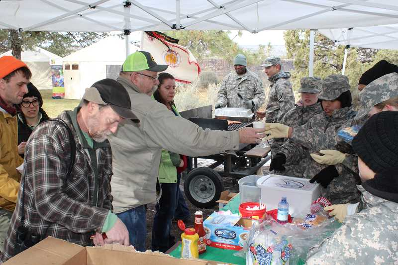 HOLLY M. GILL - Fourteen cadets from the Madras High School JROTC program served a free lunch to visitors at Eagle Watch.