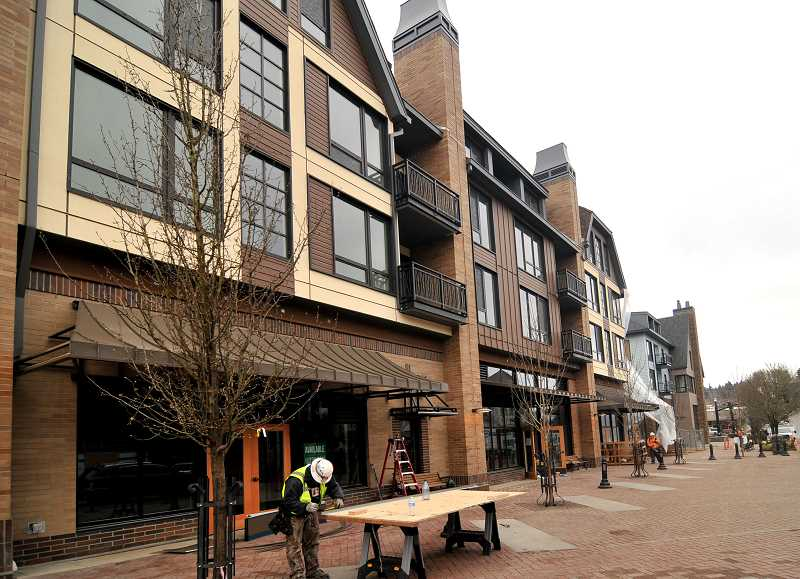 REVIEW PHOTO: VERN UYETAKE - Construction fencing is down and the sidewalks are open along First Street in downtown Lake Oswego, where the finishing touches are being applied to The Windward. Construction started on the mixed-use development in late 2015.