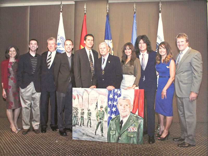 SUBMITTED PHOTO: JIM THAYER - Thayer (center) poses for a photo with his family at an event honoring his military service.