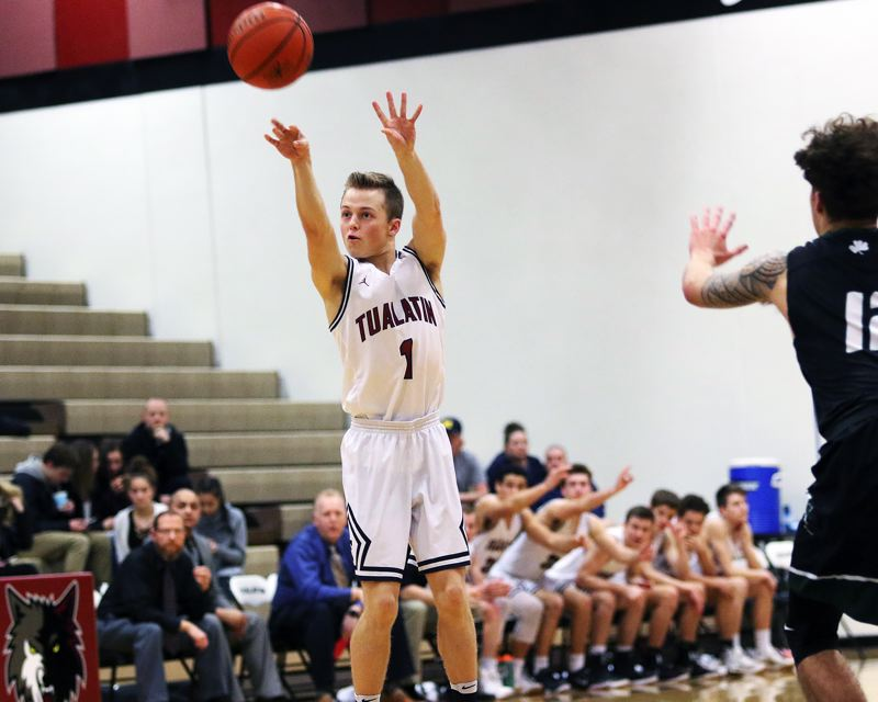 DAN BROOD - Tualatin junior Caden Dickson sinks a 3-pointer during Tuesday's state playoff game.