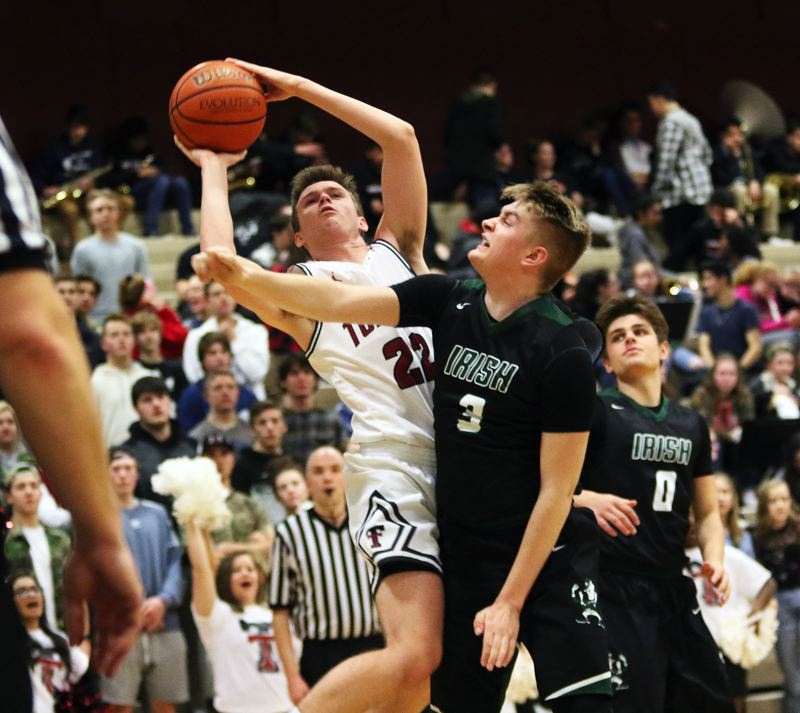 DAN BROOD - Tualatin senior Nathan Platter (22) puts up a shot against Sheldon senior Zak Hankins during Tuesday's Class 6A state playoff game.