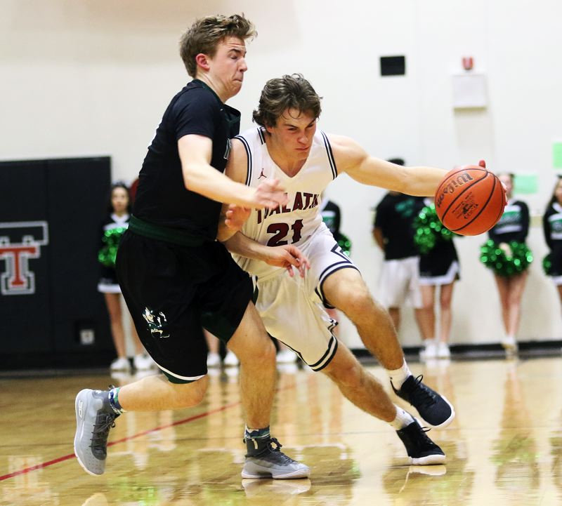DAN BROOD - Tualatin senior Lucas Noland (right) looks to drive past Sheldon's Zak Hankins during Tuesday's Class 6A state playoff game.