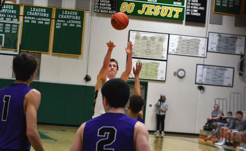 TIMES PHOTO: MATT SINGLEDECKER - Jesuit point guard Will Sheaffer and the Crusaders made 19 three-pointers against South Eugene on Wednesday.