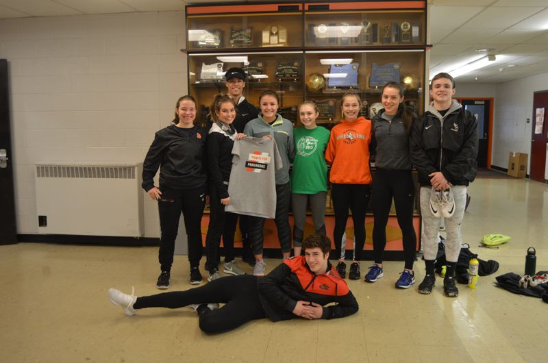 SPOTLIGHT PHOTO: NICOLE THILL - Members of the Scappoose High School track team are hosting a fundraiser next week to collect money for Parkinsons disease research. The team is organizing a jog-a-thon and staff-versus-student basketball game to raise money.