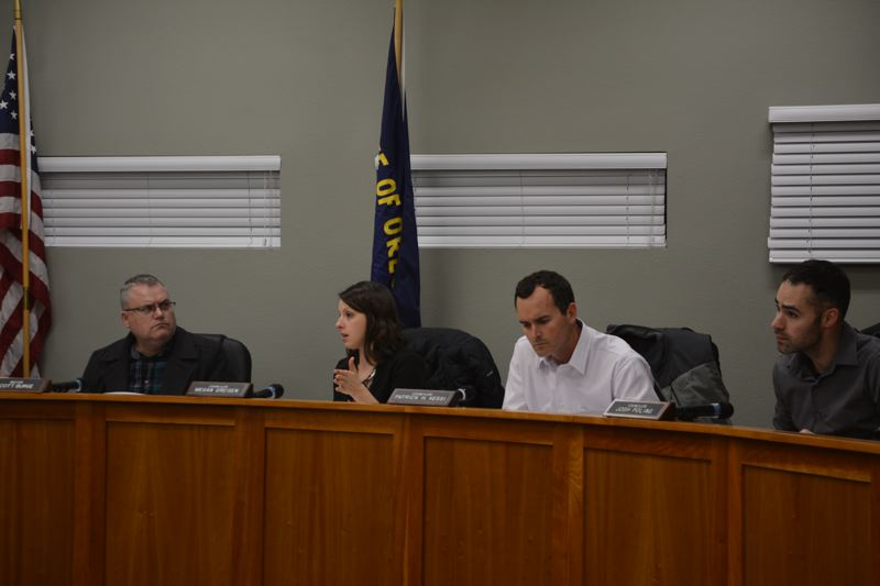 SPOTLIGHT PHOTO: COURTNEY VAUGHN - Scappoose Mayor Scott Burge (left) listens as City Councilor Megan Greisen shares her concerns over cost estimates for a restroom at a new park on Seely Lane slated to be developed this summer. To her right, Councilors Patrick Kessi and Josh Poling listen.