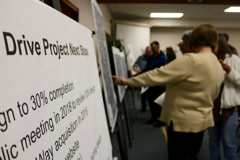 OUTLOOK PHOTO: ZANE SPARLING - About 70 people discussed the proposed changes to Northeast 238th Drive during an open house at Wood Village Baptist Church on Monday, Feb. 26.